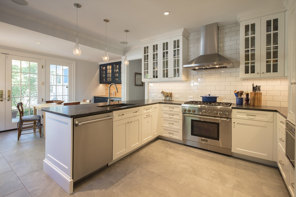 The U201cUu201d Shaped Kitchen Layout Maximizes Work Space. The Wet Bar Was Placed  Adjacent To The Breakfast Table. The Porcelain Tile Floor Is Kept Warm With  Hot ...